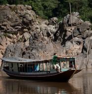 laos boat-mekong-river-laos-man
