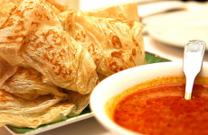 Crispy and chewy roti prata with fish curry